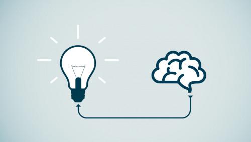 Illustration: ein Gehirn, verbunden mit einer Glühbirne