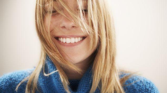 Das Bild zeigt eine junge, lächelnde Frau.