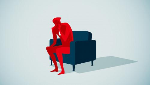 Illustration: Ein verzweifelt wirkender Mann sitzt auf dem Sofa.