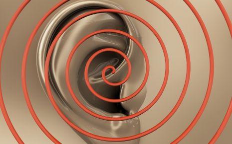 Tinnitus: In dieser Grafik sieht man eine Spirale über einem Ohr.
