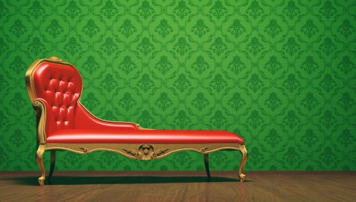 Stark stilisierte Couch als Symbol für Psychoanalyse