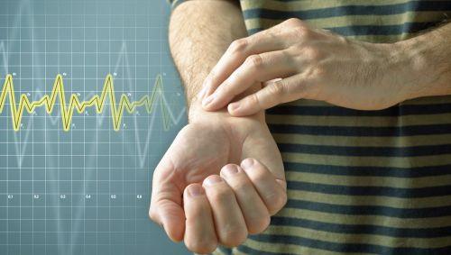 Das Bild zeigt eine Illustration, die einen Mann zeigt, der seinen Puls am Handgelenk misst.