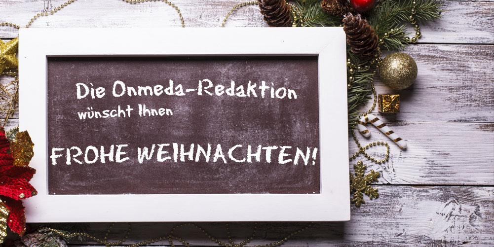 Onmeda-Weihnachtsgrüße auf einer Tafel